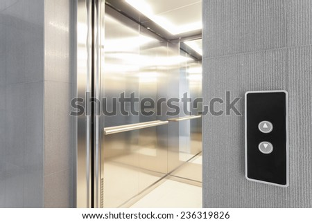 Close-up of entry to elevator in modern building - stock photo