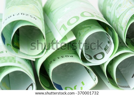 close up of 100 euro banknotes rolled up - stock photo