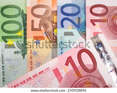 Close up of Euro banknotes with 10 Euros in focus - stock photo