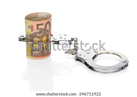 Close-up Of Euro Notes With Handcuffs On White Background - stock photo