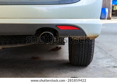 Close up of exhaust pots of white car - stock photo