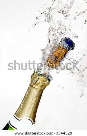 Close-up of explosion of champagne bottle cork with white background - stock photo
