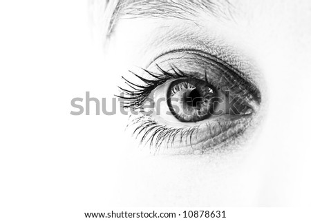 Close-up of eye and face in black and white. Shallow DOF. - stock photo