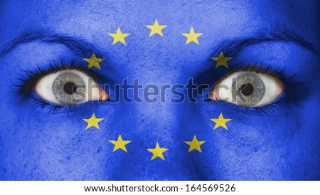 Close up of eyes. Painted face with flag of European Union