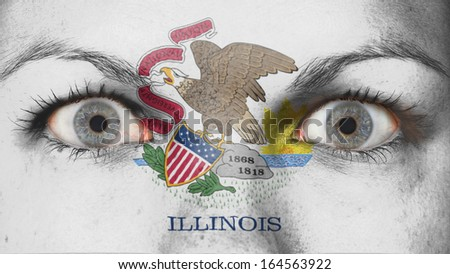 Close up of eyes. Painted face with flag of Illinois - stock photo