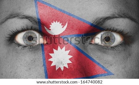 Close up of eyes. Painted face with flag of Nepal