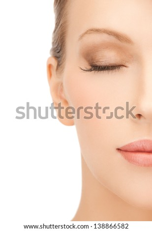 close up of face of beautiful young woman - stock photo