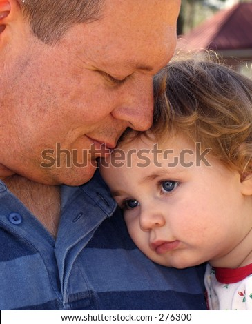 Close up of father and daughter in color - stock photo
