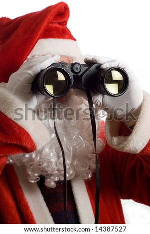 Close up of Father Christmas looking at the future business strategy with binoculars to the front - stock photo