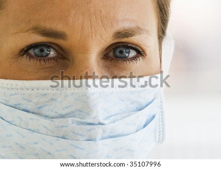 Close up of Female Doctor with Mask on