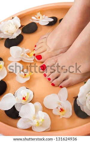 Close-up Of Female Feet Getting Spa Aroma Therapy - stock photo