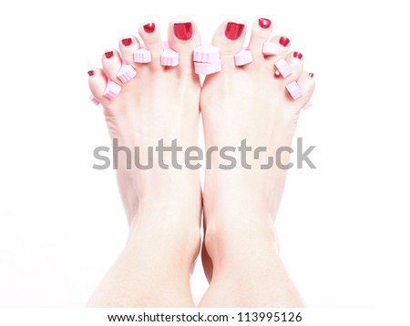 Close-up of female feet with red polished nails carefree, chiropody - stock photo