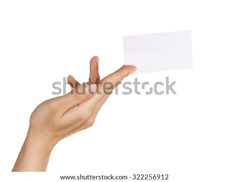 Close up of female hand holding/ giving blank business card isolated on white background - stock photo