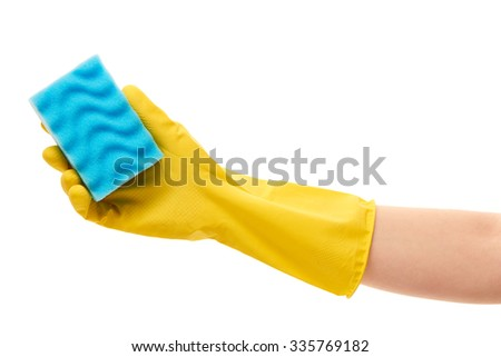 Close up of female hand in yellow protective rubber glove holding blue cleaning sponge against white background