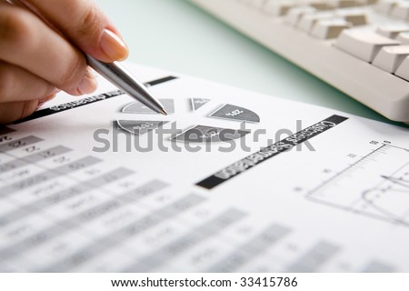 Close-up of female hand making note in business-plan - stock photo