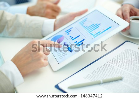 Close-up of female hands during work with touchpad - stock photo