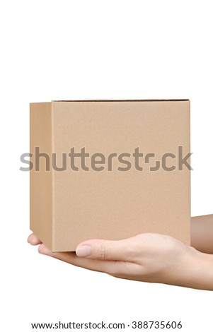 Close-up of female hands holding cardboard box  isolated on white - stock photo