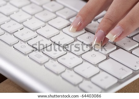 Close-up of female hands lying on the keyboard