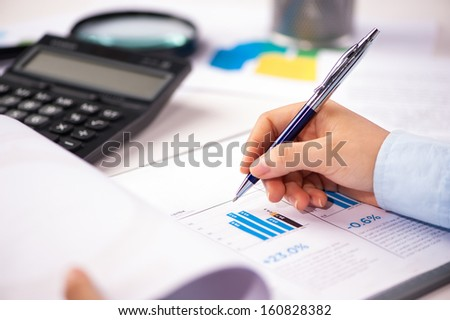 Close-up of female hands. Pen on papers  - stock photo