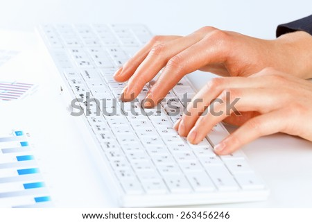 Close up of female hands typing on keyboard