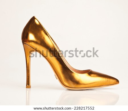 Close-up of female high-heeled shoes over white background - stock photo
