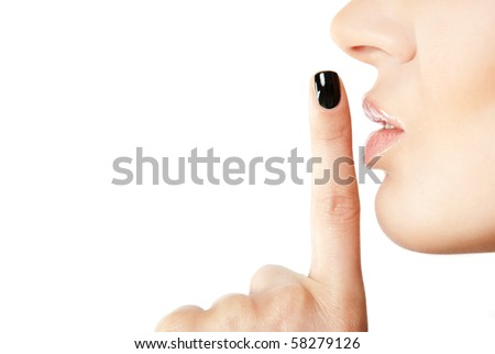 Close-up of female index finger with black fingernail put on her lips, making silence sign - stock photo