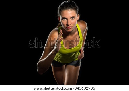 Close up of female jogger sprint runner determined athlete start of race training fitness cardio cross fit - stock photo