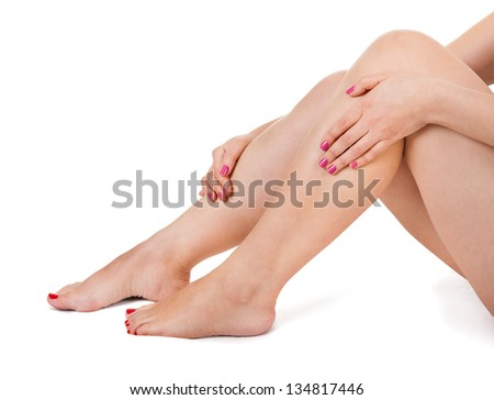 Close-up Of Female Legs Isolated On White Background - stock photo