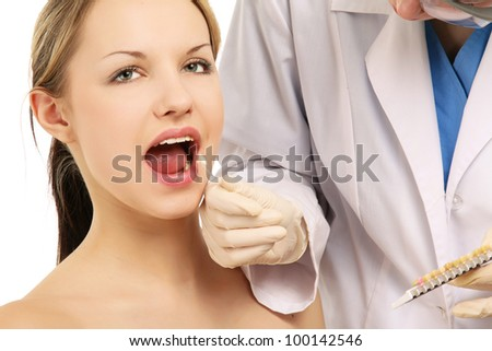Close-up of female patient at dentist's - stock photo