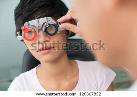 Close-up of female patient visiting optician - stock photo