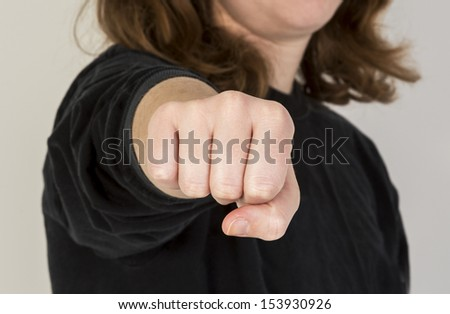 Close up of female punching her fist with a shallow depth of field - stock photo