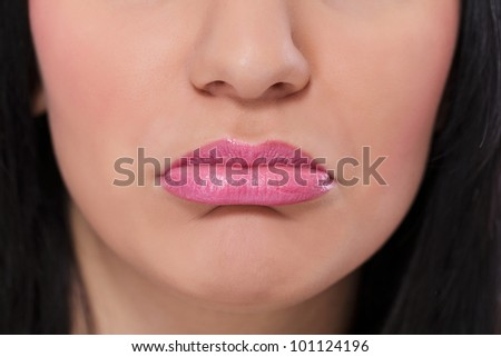 Close up of female  sadness mouth - stock photo