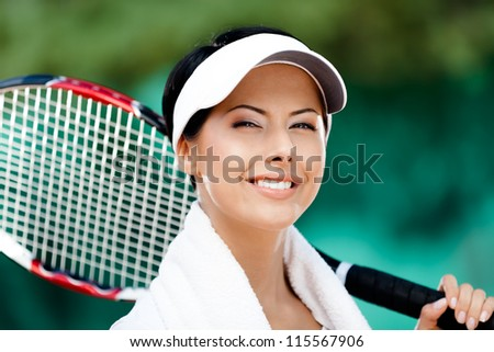 Close up of female tennis player with towel on her shoulders - stock photo