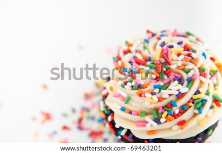 Close Up of Festive Cupcake Frosting Top with Sprinkles - stock photo