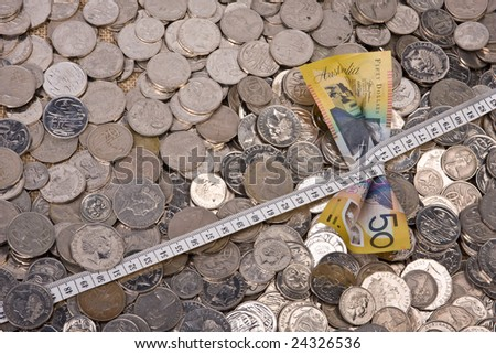 close up of fifty dollar note - with tape measure tightened - stock photo