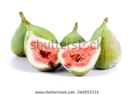 Close-up of figs on white background - stock photo