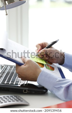 Close-up of financial advisor sitting at office at fill the document. Business people.