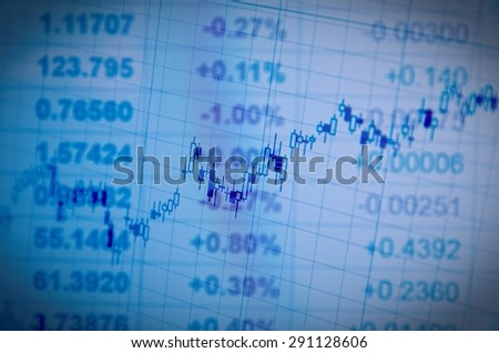 Close-up of financial data on PC screen. Multiple exposure. - stock photo