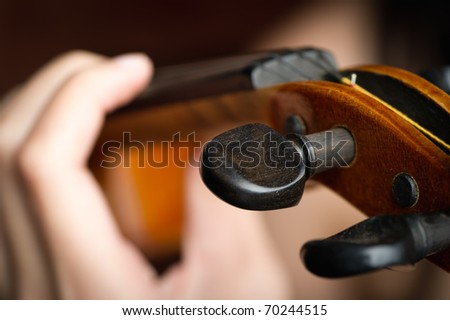 close-up of fingers on a violin string - stock photo