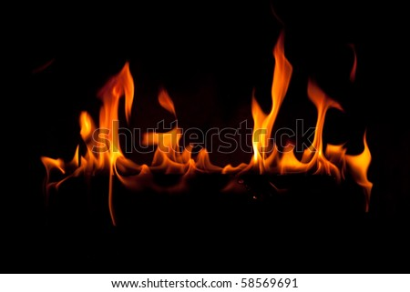 Close up of fireplace with orange flames - stock photo
