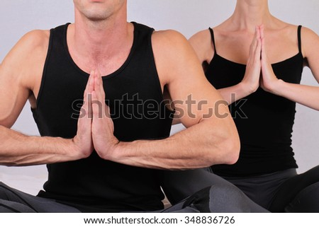 Close up of fitness couple doing yoga exercises. Love, togetherness, relationship, harmony, sport and lifestyle concept - stock photo