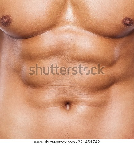 Close up of fitness man torso with beautiful six pack - stock photo
