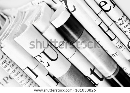 Close-up of folded newspapers - stock photo