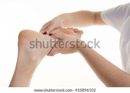 Close up of foot of a man with hands of female therapist