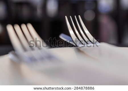 Close up of fork and knife in a restaurant - stock photo