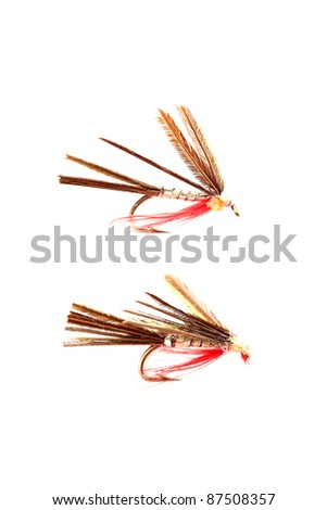 Close-up of four colorful fishing flies. Shallow dof - stock photo