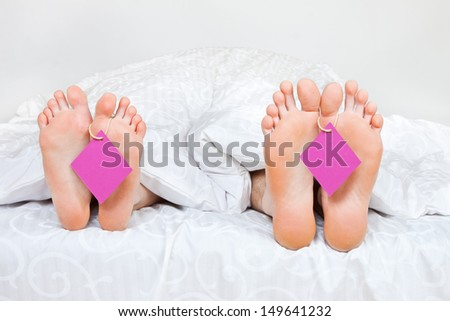Close up of four feet in a bed with space for text
