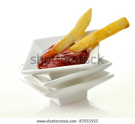 Close Up Of French Fries And Ketchup On White Background