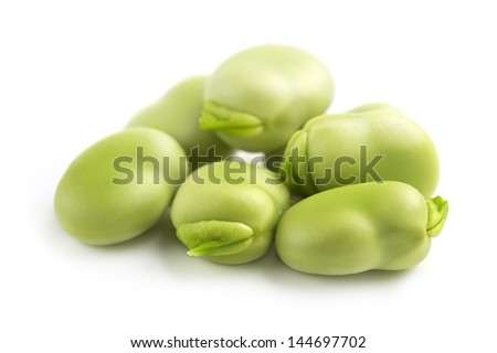 close up of fresh broad beans on white background - stock photo