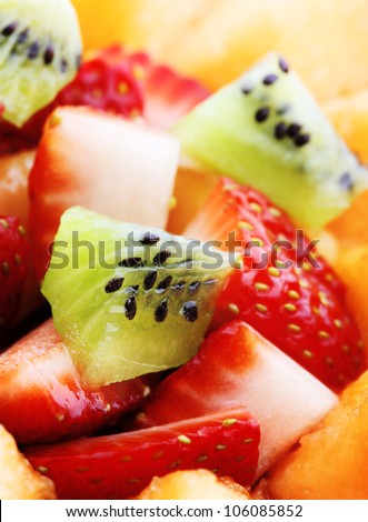 Close-up of Fresh Fruit Salad - Shallow DOF - Focus on front Kiwi - stock photo